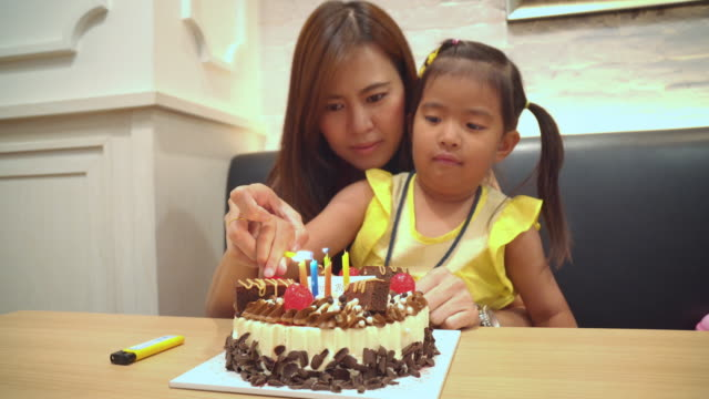 Mother and Little girl Birthday Candles,Close-up video