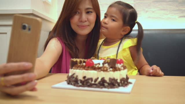 Mother and Little girl Selfie at Birthday Cake Party video