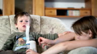 Mother and sick little boy using nebulizer to inhale medicine video