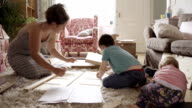 Mother And Son Assembling Flatpack Draws DIY video