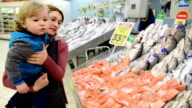 Mother and son at fish market video