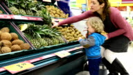 Mother and son at grocery store video