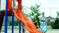 Mother and son at playground video