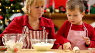Mother and son baking Christmas cookies video