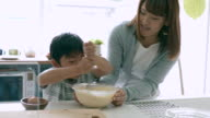 Mother and son baking together video