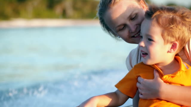 Mother and son enjoying sea travel by boat video
