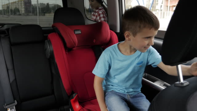 Mother and son fastening seatbelts to be prepared for the ride video