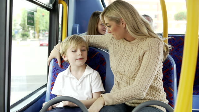 Mother And Son Going To School On Bus Together video