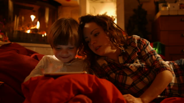 Mother and son in a New Year's Eve video
