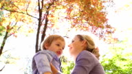 Mother and son in the autumn park. video