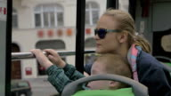 Mother and son looking at city from double-decker bus video