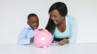 Mother and son saving money for his education video