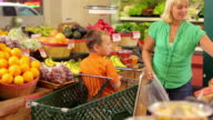 Mother and son shopping for groceries video