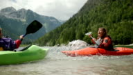 HD: Mother And Son Splashing With Paddles video