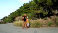 Mother and son walking on mountain trails video