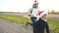 mother and son with Christmas cap run in the free one video
