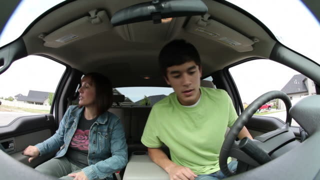 Mother and teenage son get into car video