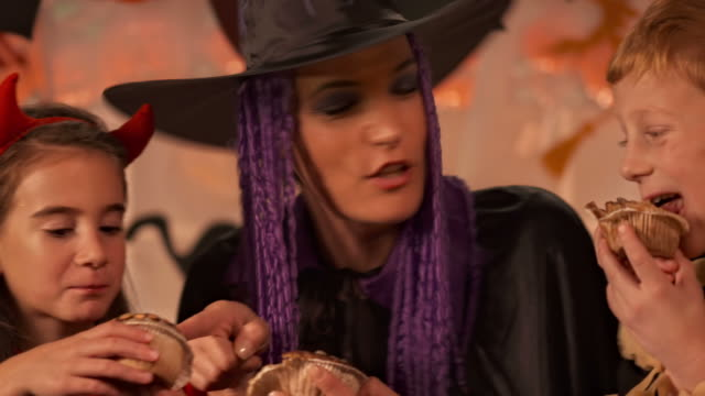 HD: Mother And Two Children Eating Halloween Pastries video