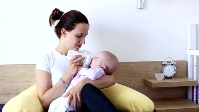 HD: Mother Bottle-Feeding Her Baby video