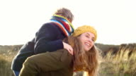 MS Mother carrying son piggyback video