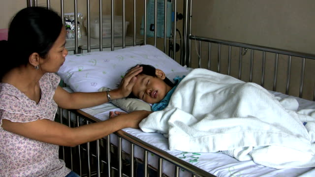 Mother Checks On Her Sick Boy In The Hospital video