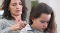 HD: Mother Combing Her Daughter's Hair video