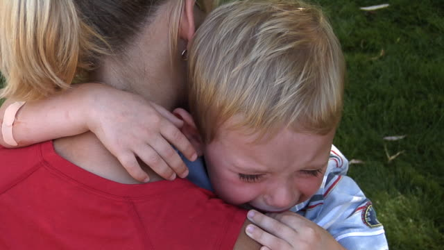 Mother comforting crying child video