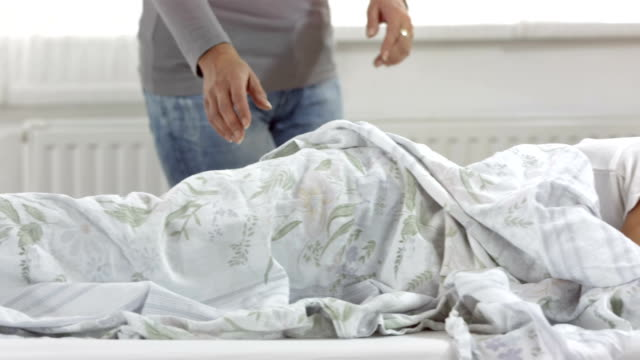 HD DOLLY: Mother Covering Her Sick Son With Blanket video