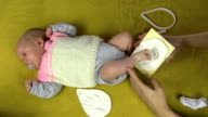 mother create newborn baby footprint on special material video