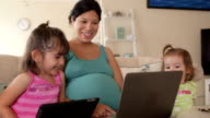 Mother & Daughter Laugh at Funny Video video