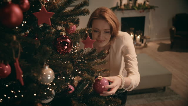 Mother decorating christmas tree video