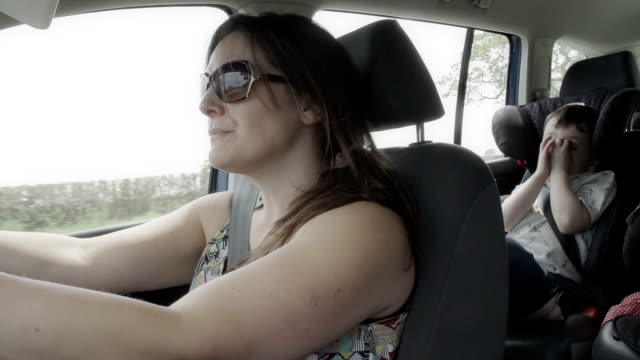 Mother Driving Her Young Son Around In Car video