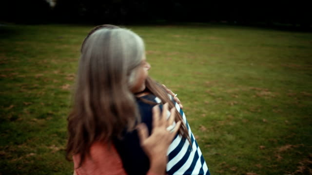Mother Embracing Her Daughter In The Park video