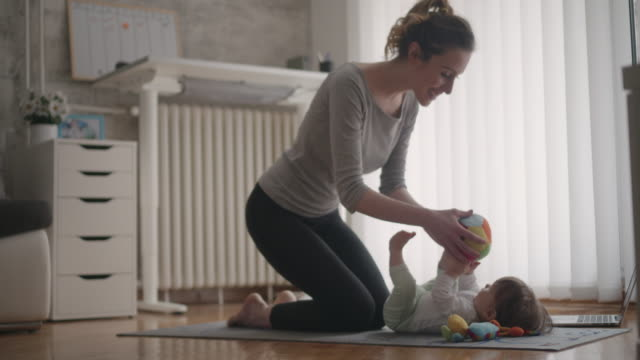 4K: Mother Exercise With Her Baby At Home. video