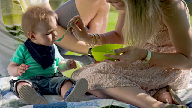 MS Mother Feeding Her Baby Outdoor video