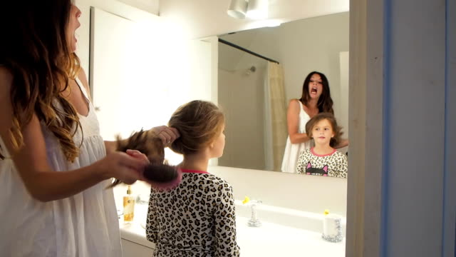 Mother Fixing Daughters Hair video