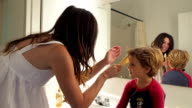 Mother Fixing Little Boy's Hair video