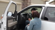 Mother gives son a hug as he gets in truck video