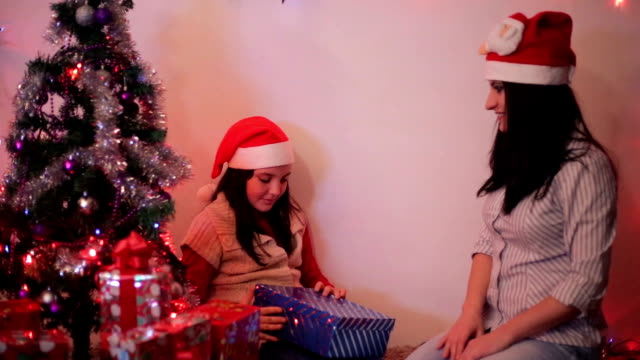mother gives the child a gift for Christmas video