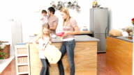 Mother giving girl the school lunch in the kitchen video