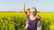 HD SLOW MOTION: Mother Giving Piggyback Ride video