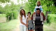 Mother, grandfather and children in the park video