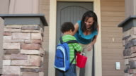 Mother greets child coming home from school video