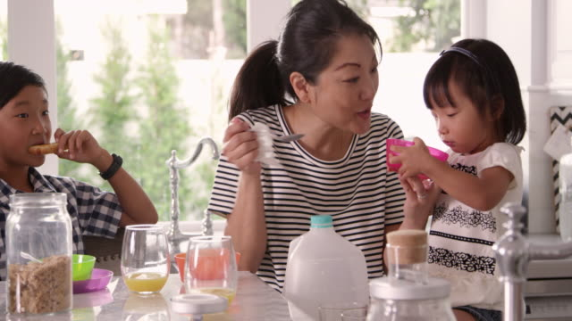 Mother Helping Children With Breakfast Shot On R3D video