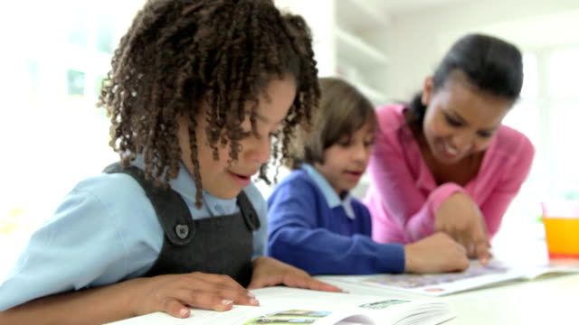 Mother Helping Children With Homework video