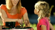 Mother Helping Cut Meat For Daughter video