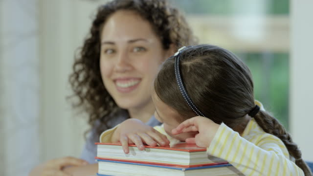 Mother helping daughter with homework video
