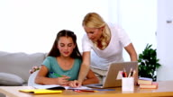 Mother helping her daughter with homework video