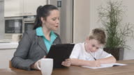 HD DOLLY: Mother Helping Her Son Doing Homework video