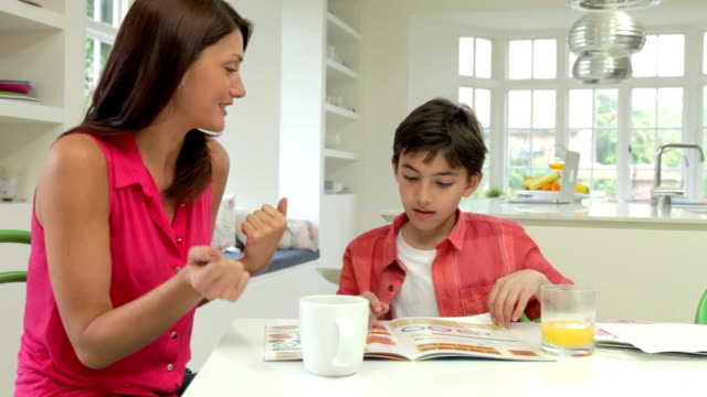 Mother Helping Son With Homework video